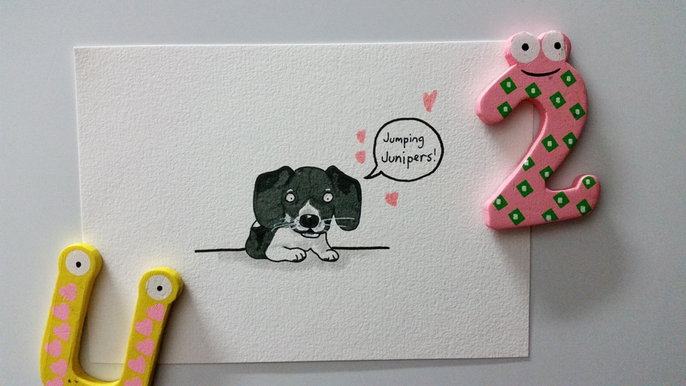 A drawing of a little grey and white puppy called Juniper.