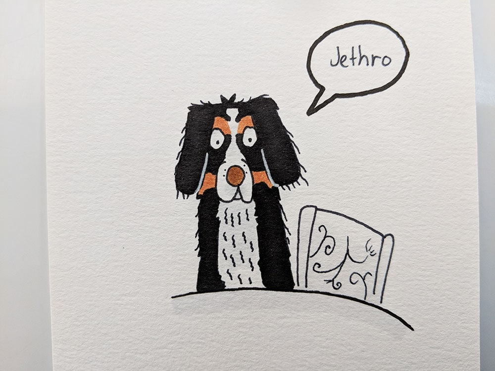Jethro is now coloured in. He's black with tan coloured eyebrows, and a white chest and muzzle. He's still sitting at the table waiting for dinner.