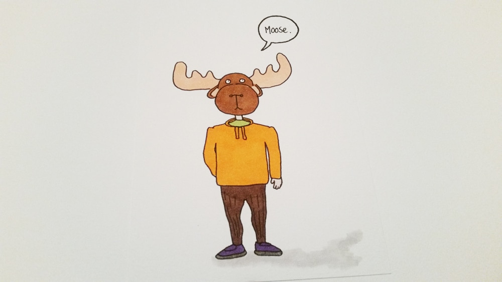 Picture of a person wearing a dress up moose head costume with just normal clothes