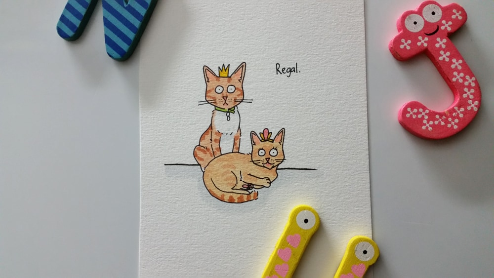 A drawing of a cat and a kitten sitting regally