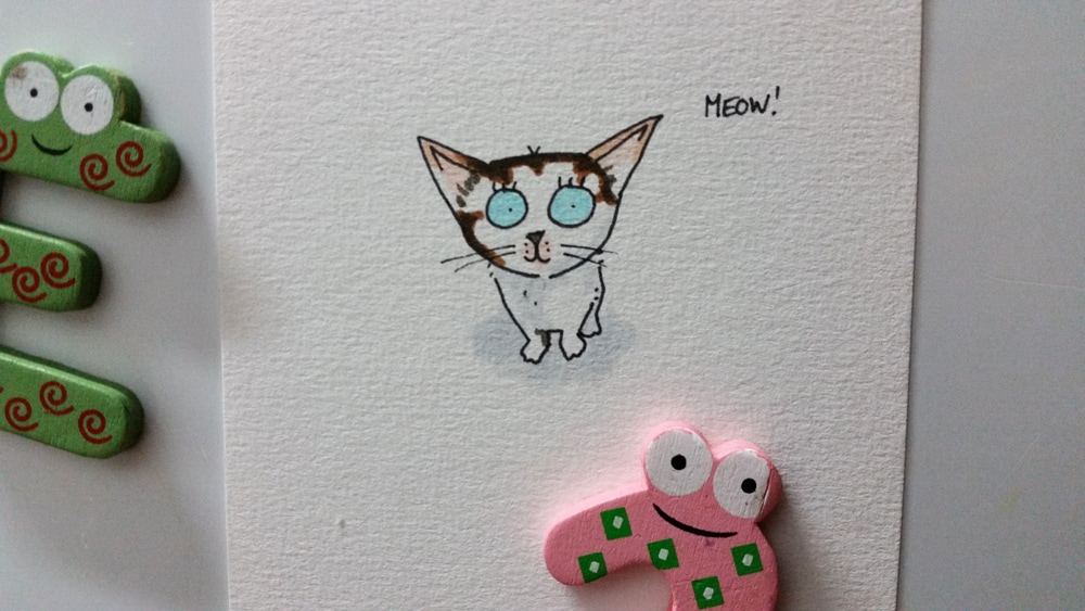 A cartoon drawing of a cute and curious kitten called Eevee!