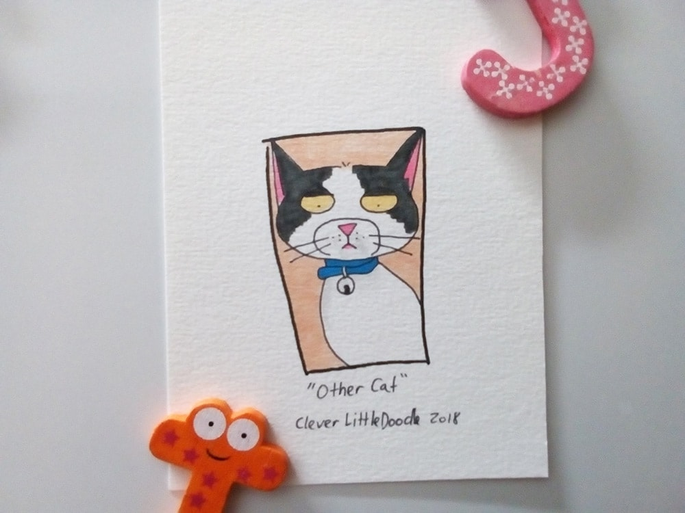 """Drawing of a black and white tabby with a look on its face that says """"I'm not impressed."""""""