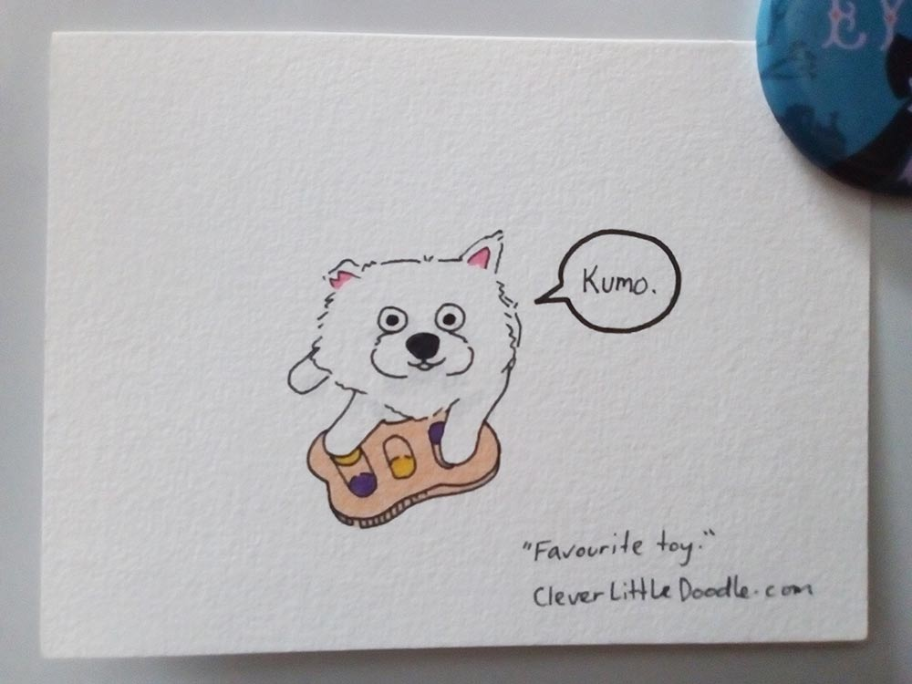 Coloured drawing of Kumo the Japanese Spitz playing with his favourite toy.