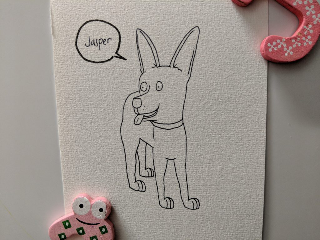 Drawing of a black kelpie called Jasper. He's standing on all four legs with his head turned to the side and his tongue poking out.