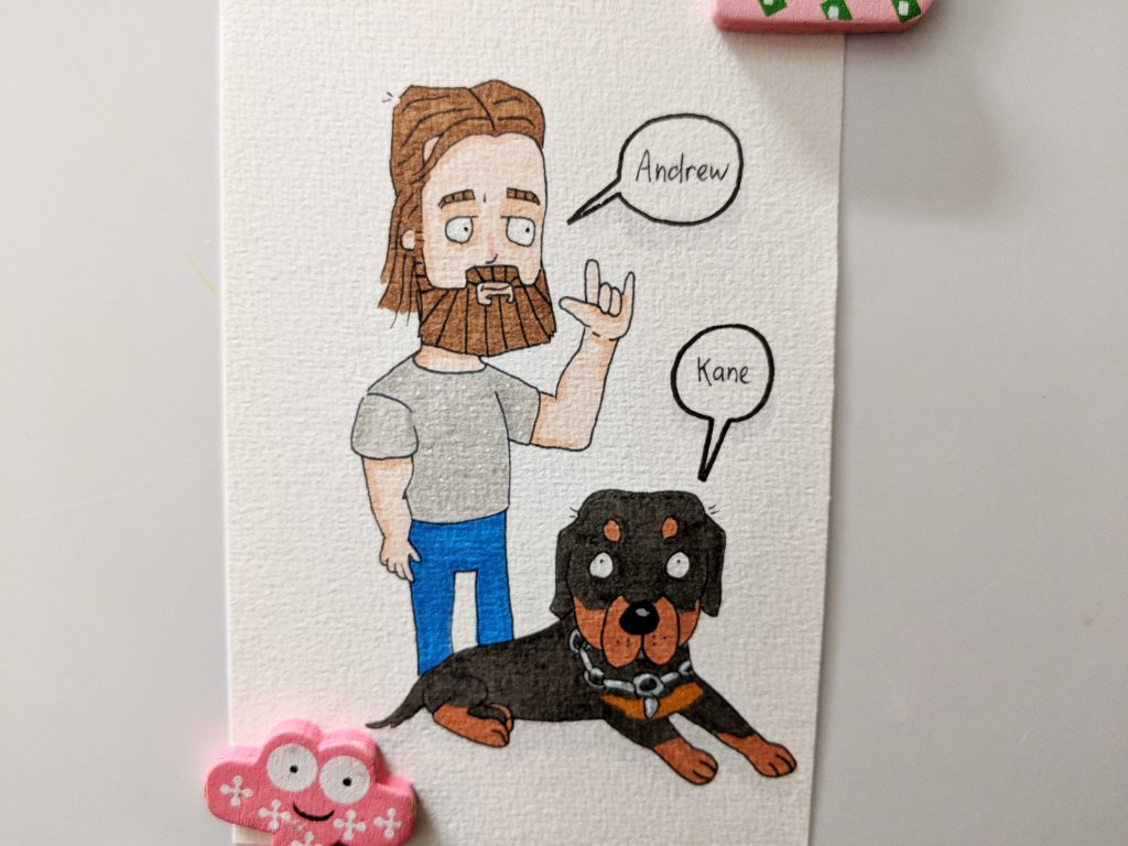 Andrew and Kane coloured drawing. Andrew has a beard, and Kane is a rottweiler.