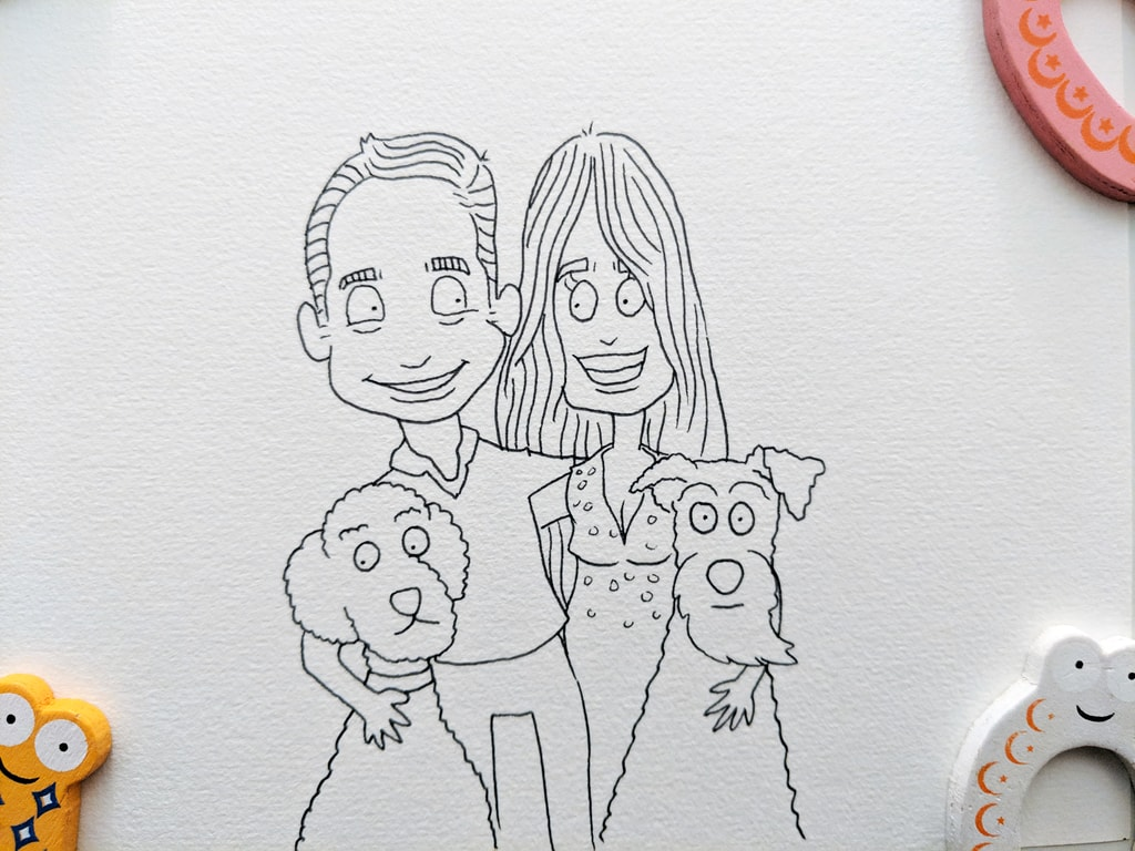 Line drawing of Edith the Labradoodle and Art the Airedale Terrier with their human buddies.