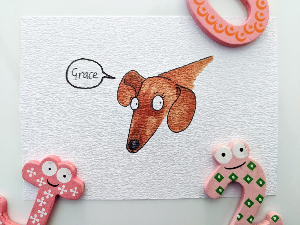 Colour drawing of Grace the Dachshund. She is a lovely tan colour with dark points on her nose and ears.