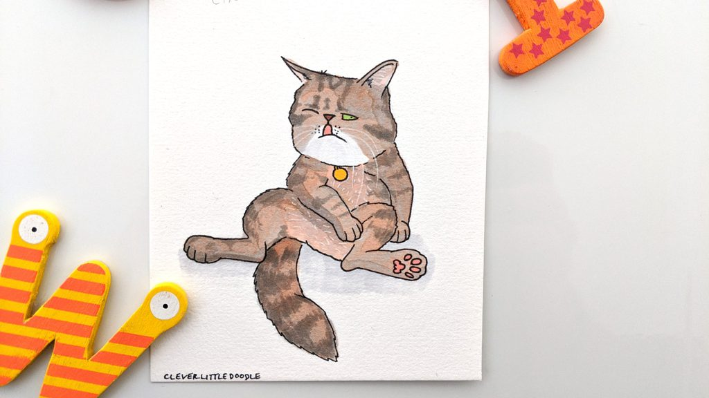 A drawing of Choccie the Exotic Short Hair Cat. He's sitting on his bottom like a person with one leg/arm holding him up and the other laying across his belly. He has light brown fur with dark markings, a white chin and green eyes.